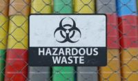 hazardous waste sign with containers